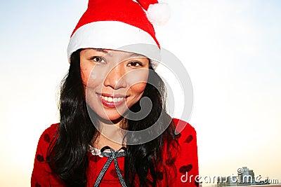 Asian woman wearing a Santa hat.