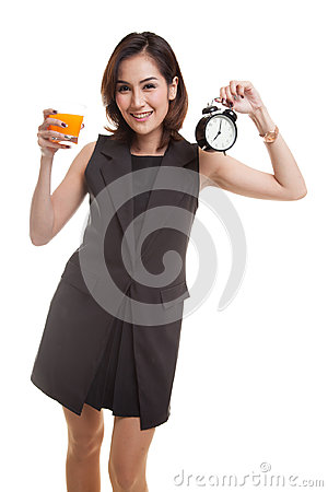 Free Asian Woman With A Clock Drink Orange Juice. Stock Images - 94962214