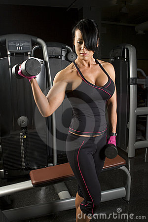 Asian woman working out with weights