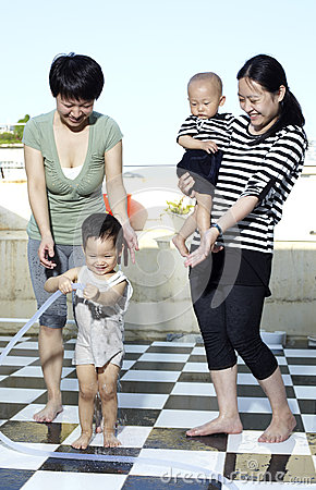 Asian women and Children play with the water
