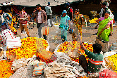 Asian women choose the flowers on crowded Flower Market Editorial Photo