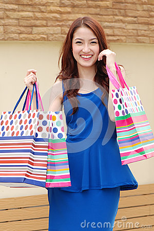 Free Asian Women On Holding A Lot Of Shopping Bag In Super Market Stock Photos - 34014453