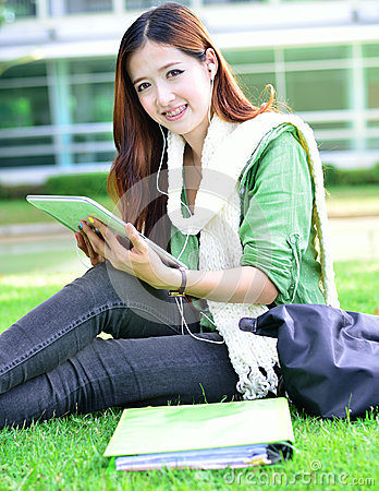 Asian women student learning with computer tablet