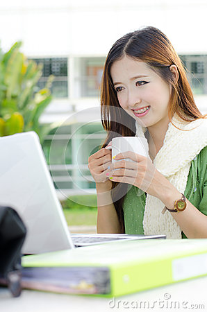 Asian women student smiling with coffee cup