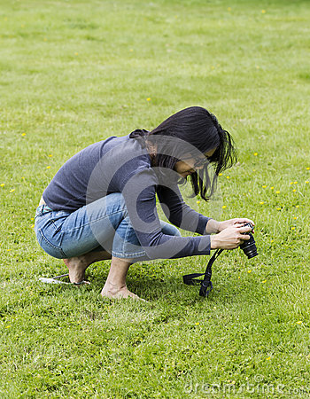Asian women taking photos of flowers