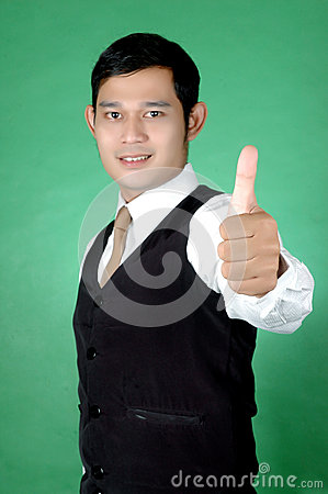 Asian young man thumbs-up