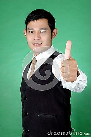 Asian young man thumbs-up