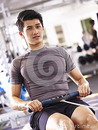 Free Asian Young Man Working Out On Rowing Machine Royalty Free Stock Photography - 104720937