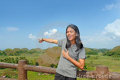 Asian young tourist showing landmark
