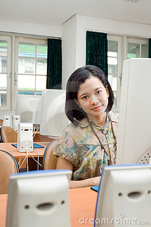 Asian young woman in computer classroom
