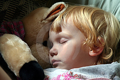 Asleep with a stuffed horse