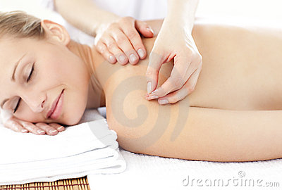 Asleep woman receiving an acupuncture treatment