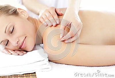 Asleep woman receiving an acupuncture treatment