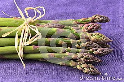 Asparagus on purple napkin