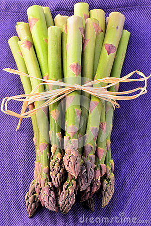 Asparagus on purple napkin