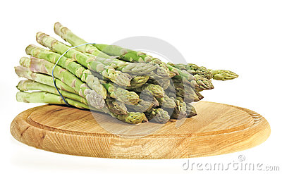 Asparagus vegetable on wooden chopping board