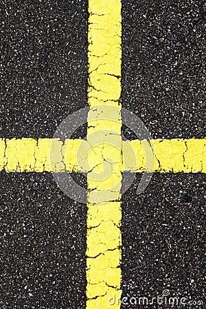 Asphalt with cross yellow line