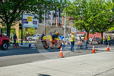Asphalt paving crew Editorial Stock Image