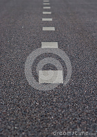 Asphalt road with a marking strips