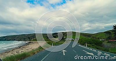 Asphalt road near the ocean shore.Shevelev. stock footage