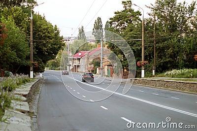 Asphalt road with white markings on city street