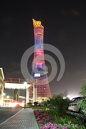 Aspire Tower aka Torch hotel in Doha, Qatar at night Editorial Photography