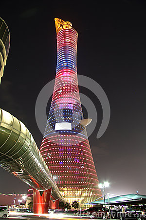 Aspire Tower aka Torch hotel in Doha, Qatar at night Editorial Image
