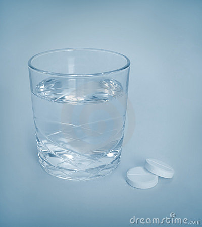 Aspirin tablets and water
