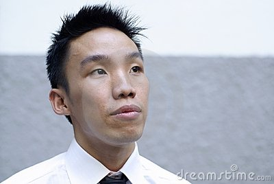 Aspiring asian male executive look up