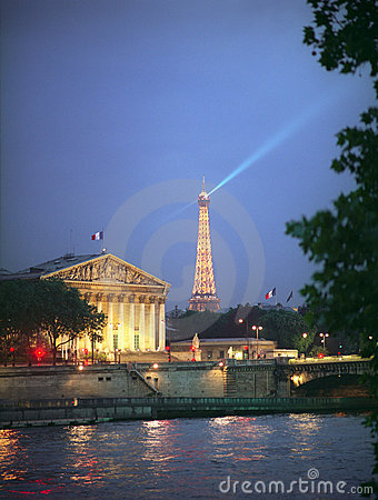 Assemblee Nationale and Eiffel Tower at night. Editorial Photography