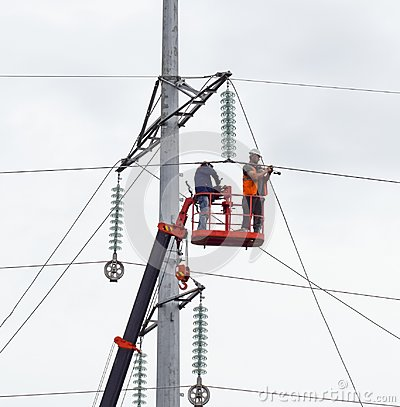 Free Assembly And Installation Of New Support Of A Power Line Royalty Free Stock Images - 101209429