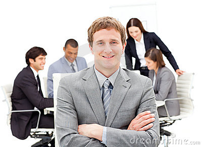 Assertive male executive with folded arms