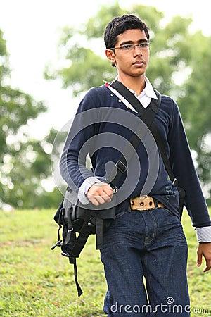 Assistant Camera man with camera bag walking