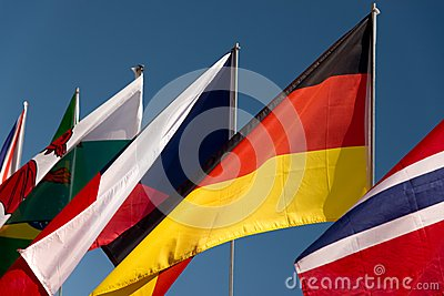 Assorted flags with a sky blue background