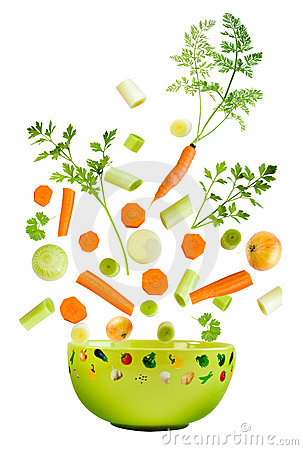 Assorted fresh vegetables falling
