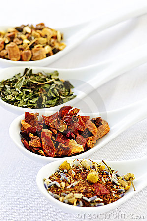 Assorted herbal wellness dry tea in spoons