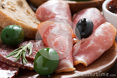 Assorted Italian antipasti - deli meats, olives and ciabatta