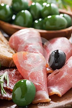 assorted Italian antipasti - deli meats, olives and ciabatta