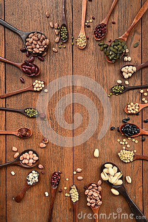 Assortment of beans and lentils in wooden spoon Stock Photo