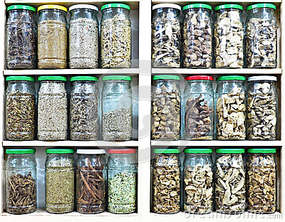 Assortment of glass jars with herbs and spices