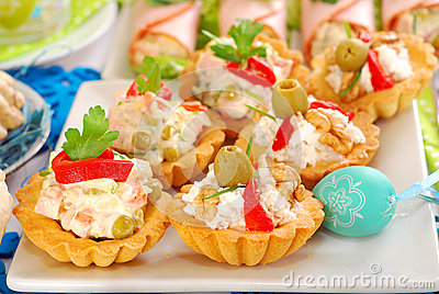 Assortment of salty mini tartlets with various filling