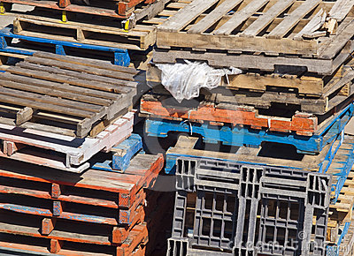 Assortment of Stacked Pallets Outside