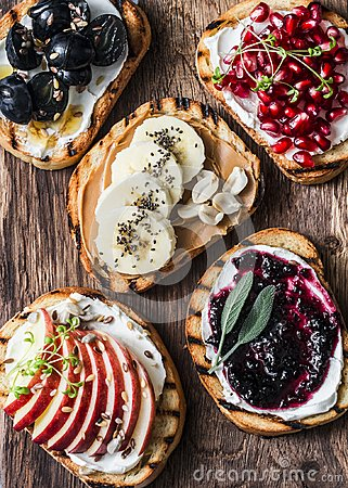 Free Assortment Sweet Sandwiches With Cream Cheese And Apple, Pomegranate, Jam, Grapes, Peanut Butter, Banana, Flax Seed, Chia, Nuts On Royalty Free Stock Photos - 111095608