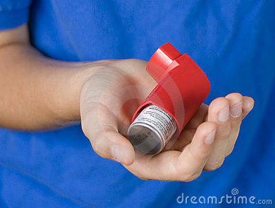 Asthma Inhaler in Hand