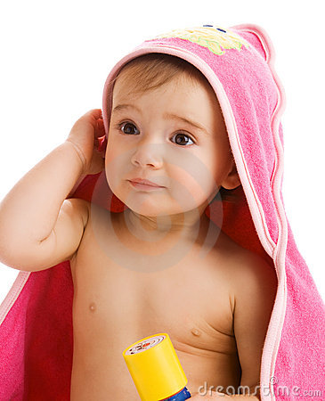 Astonished baby in towel