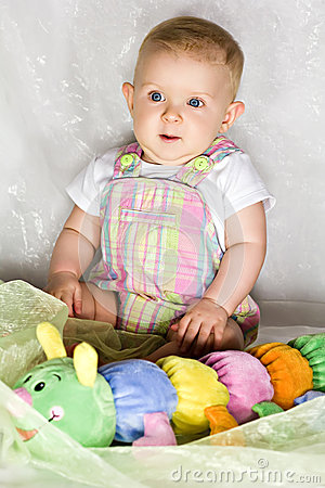 Astonished infant with toy