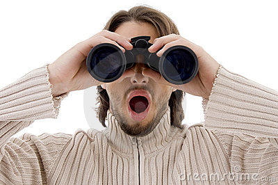 Astonished male watching through binocular
