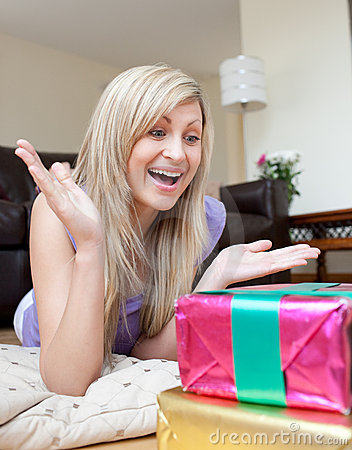 Astonished woman looking at a present