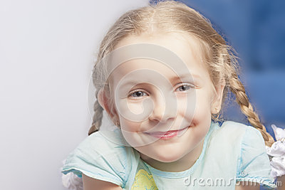 Astonishing portrait of a smiling cute little girl
