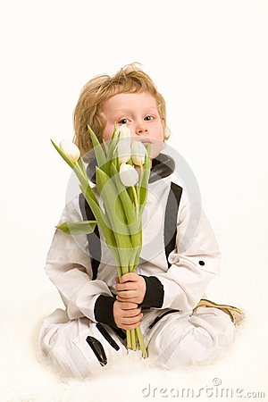 Astronaut boy holding a bouquet